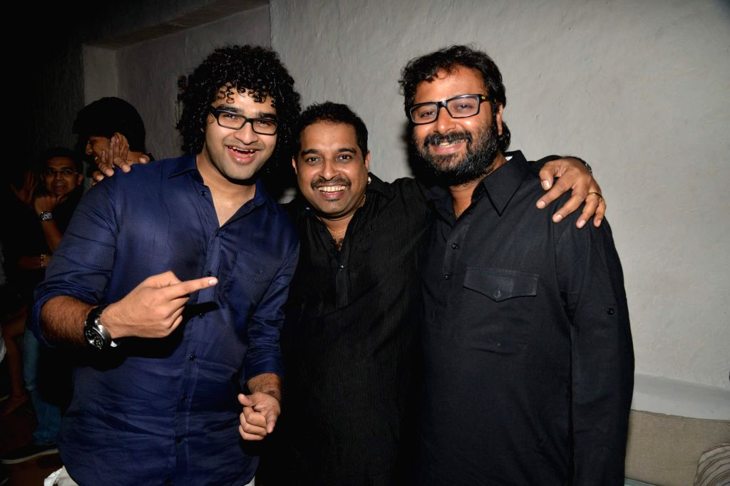 Singer Shankar Mahadevan with his son Siddharth Mahadevan during Siddharth Mahadevan`s birthday bash in Mumbai on April 17, 2014. (Photo : IANS)