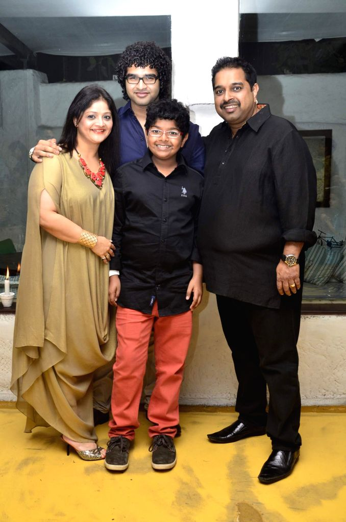 Singer Shankar Mahadevan with his wife Sangeeta Mahadevan and son Siddharth Mahadevan during Siddharth Mahadevan`s birthday bash in Mumbai on April 17, 2014. (Photo : IANS)