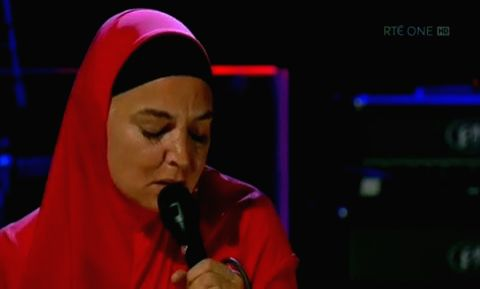 "Singer Sinead O'Connor stepped out in a traditional hijab with her son after converting to Islam in October. The 52-year-old wore a bright red abaya and matching hijab when she appeared on ""The ..."