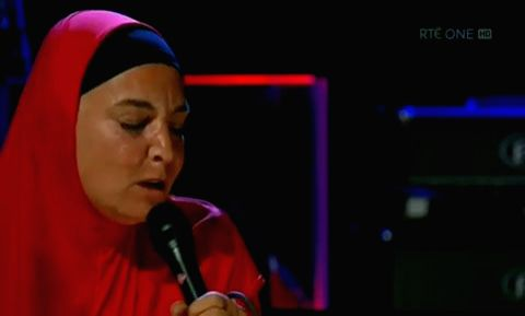 """Singer Sinead O'Connor stepped out in a traditional hijab with her son after converting to Islam in October. The 52-year-old wore a bright red abaya and matching hijab when she appeared on """"The Late Late Show"""" in Dublin on Friday night."""