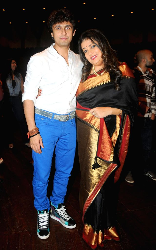 Singer Sonu Nigam and musical Composer Isheeta Ganguly during the fittings for the musical play Three Women in Mumbai on Sept. 5, 2014. - Sonu Nigam
