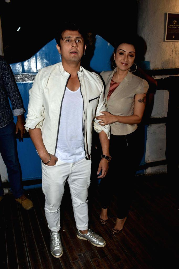 Singer Sonu Nigam with his wife Madhurima Nigam Yuvika Chaudhary at the launch of photographer Dabboo Ratnani's calendar in Mumbai, on Jan 28, 2019. - Sonu Nigam