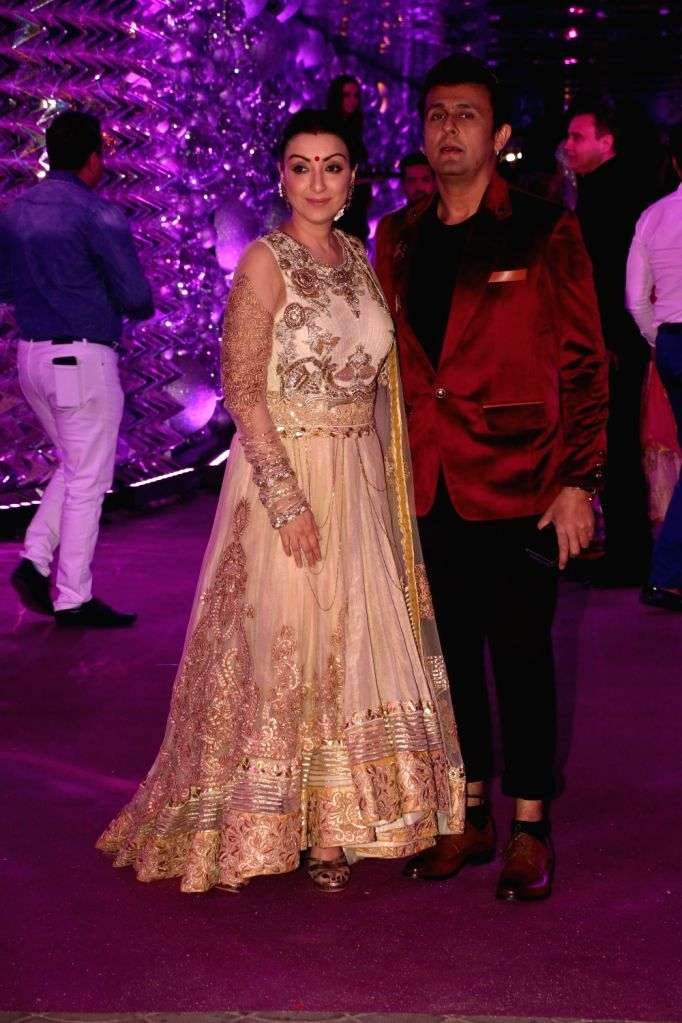 Singer Sonu Nigam with his wife Madhurima Nigam at producer Karim Morani's son Azhar Morani and Tanya Seth's sangeet ceremony in Mumbai, on Feb 7, 2019. - Sonu Nigam and Tanya Seth