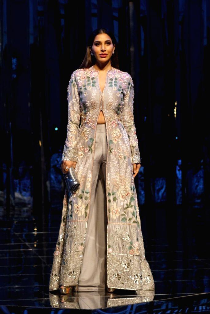 Singer Sophie Choudry walks the ramp for fashion designer Manish Malhotra's haute couture show, in Mumbai on Aug 1, 2018. - Manish Malhotra