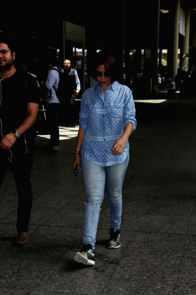 Singer Sunidhi Chauhan spotted at airport in Mumbai on May 24, 2017. - Sunidhi Chauhan