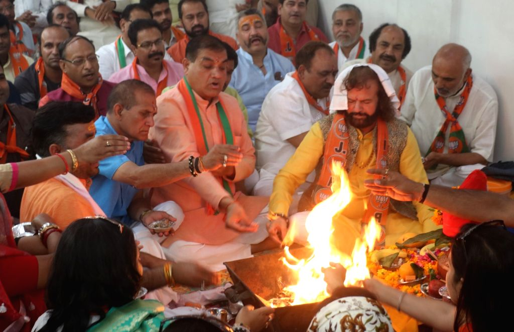 Singer-turned-politician, BJP Lok Sabha candidate from North West Delhi, Hans Raj Hans accompanied by party supporters, performs 'havan' ahead of filing nomination for the forthcoming Lok ...