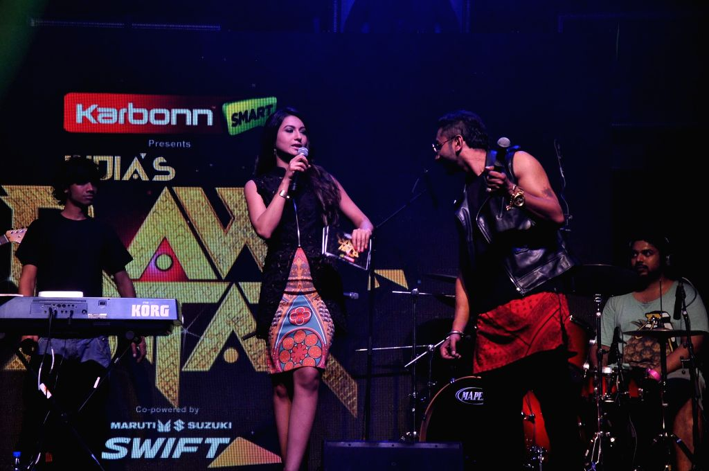 Singer Yo Yo Honey Singh and actor Gauhar Khan unveil the top 10 contestants for his upcoming television reality show India's Raw Star in Mumbai on August 13, 2014. - Gauhar Khan
