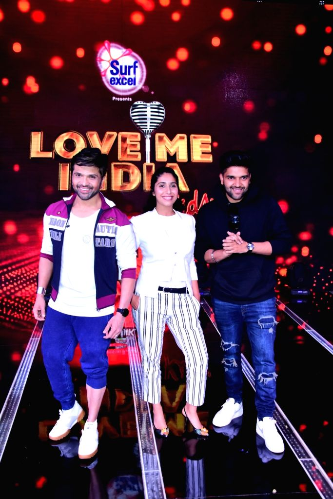 """Singers and judges of singing reality television show for kids """"Love Me India"""" - Guru Randhawa , Himesh Reshammiya and Neha Bhasin on the sets of the show, in Mumbai on Sept 15, ..."""