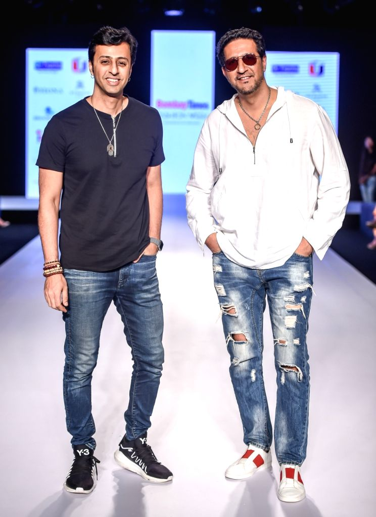Singers and music composers Suleiman and Salim Merchant during designer Reshma Merchant's show on the second day of Bombay Times Fashion Week 2018, in Mumbai on March 31, 2018.