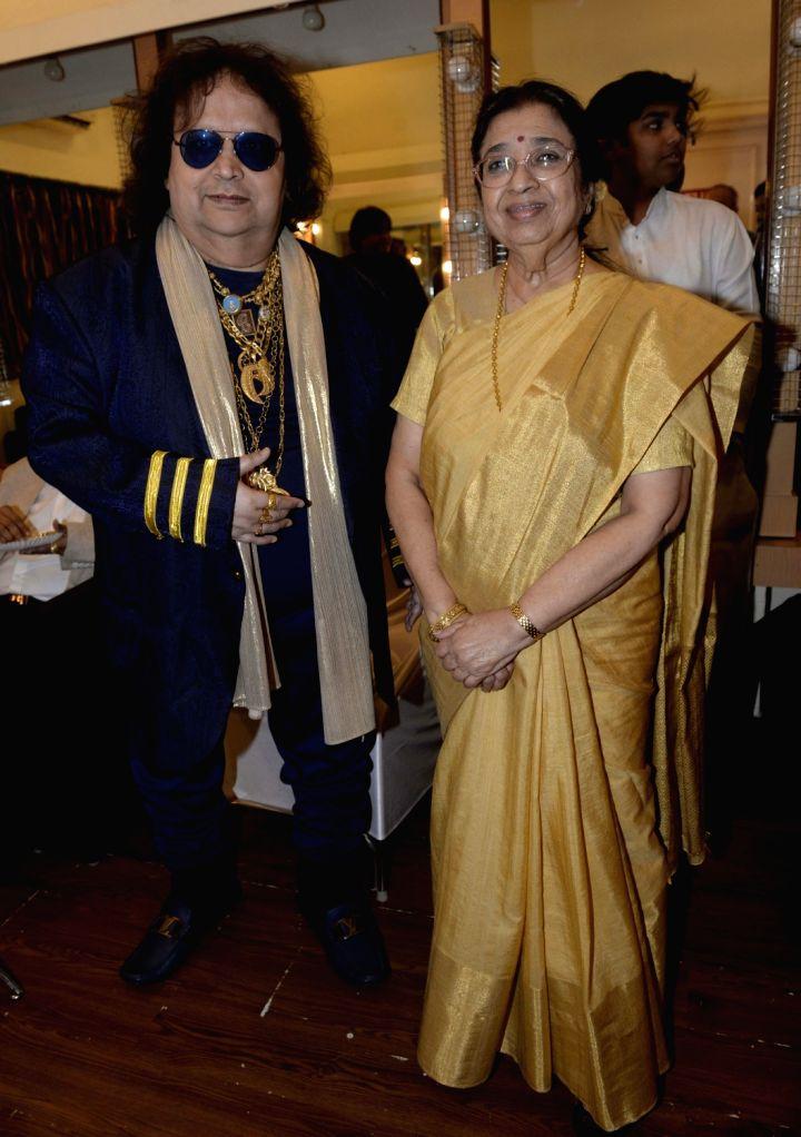 Singers Bappi Lahiri and Usha Mangeshkar at the 2019 Deenanath Mangeshkar Awards, in Mumbai, on April 24, 2019.