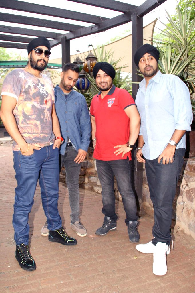 Singers Jassi Sidhu, Manj Ral, Dilbagh Singh and others during a press conference in New Delhi on July 3, 2014. - Dilbagh Singh