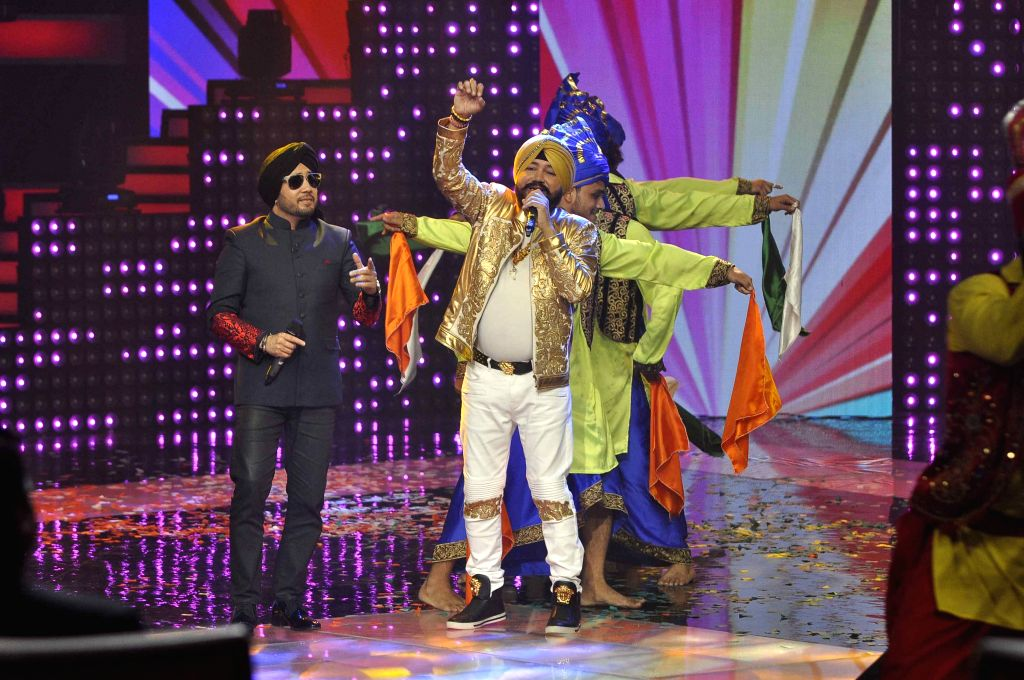 Singers Mika Singh and Daler Mehandi perform on the sets of & TV Voice India for the special episode shoot for Independence Day in Mumbai, on Aug 10, 2015. - Mika Singh