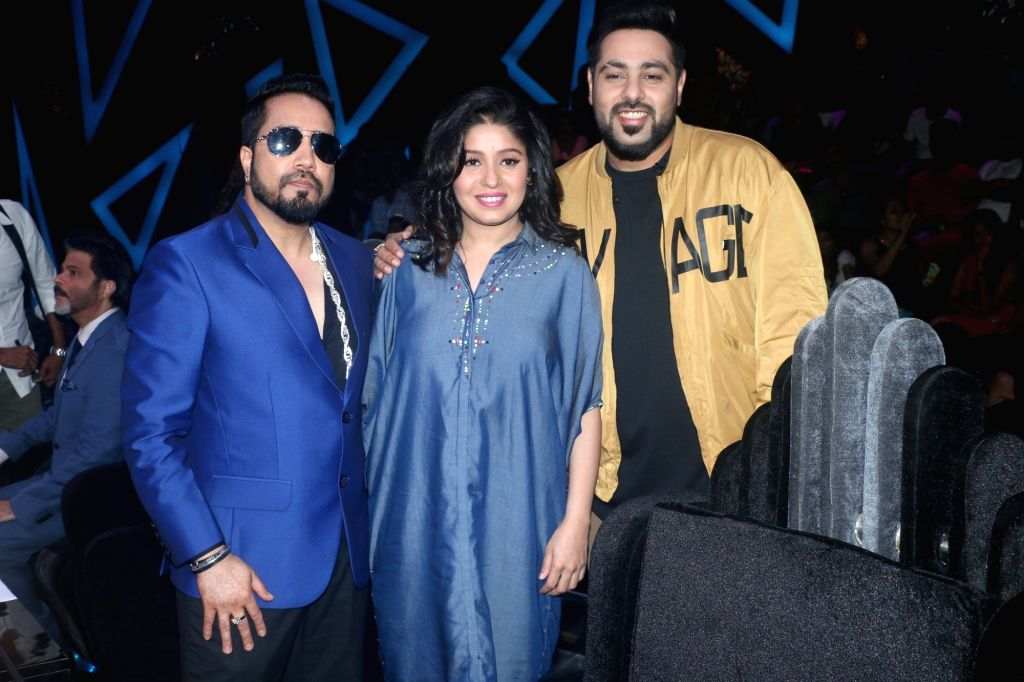 "Singers Mika Singh, Sunidhi Chauhan and rapper Badshah on the sets of reality television show ""Dance Deewane"" in Mumbai on July 23, 2018. - Mika Singh and Sunidhi Chauhan"