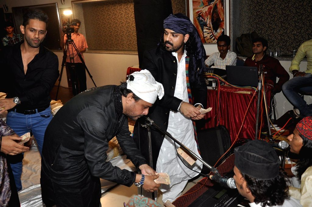 Singers Toshi Sabri, Sharib Sabri and actor Rahul Vaidya during the Toshi's Iftaar party and Sufi Mehfil in Mumbai on July 18, 2014. - Rahul Vaidya