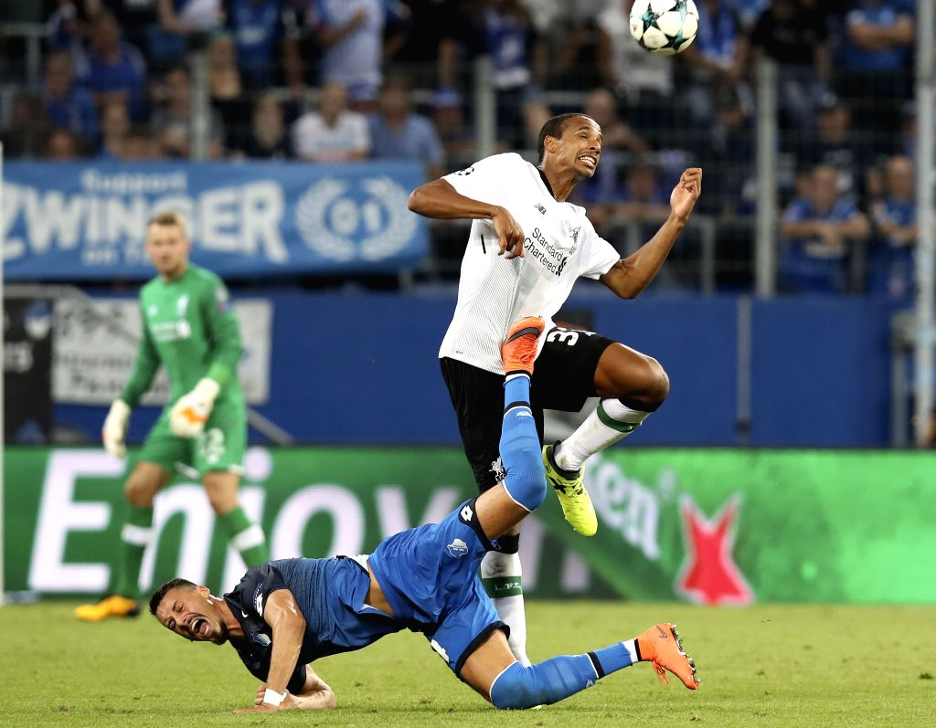 SINHEIM, Aug. 16, 2017 - Joel Matip (R) of Liverpool and Sandro Wagner of 1899 Hoffenheim compete during the UEFA Champions League Qualifying Play-Offs Round First Leg match at Wirsol ...