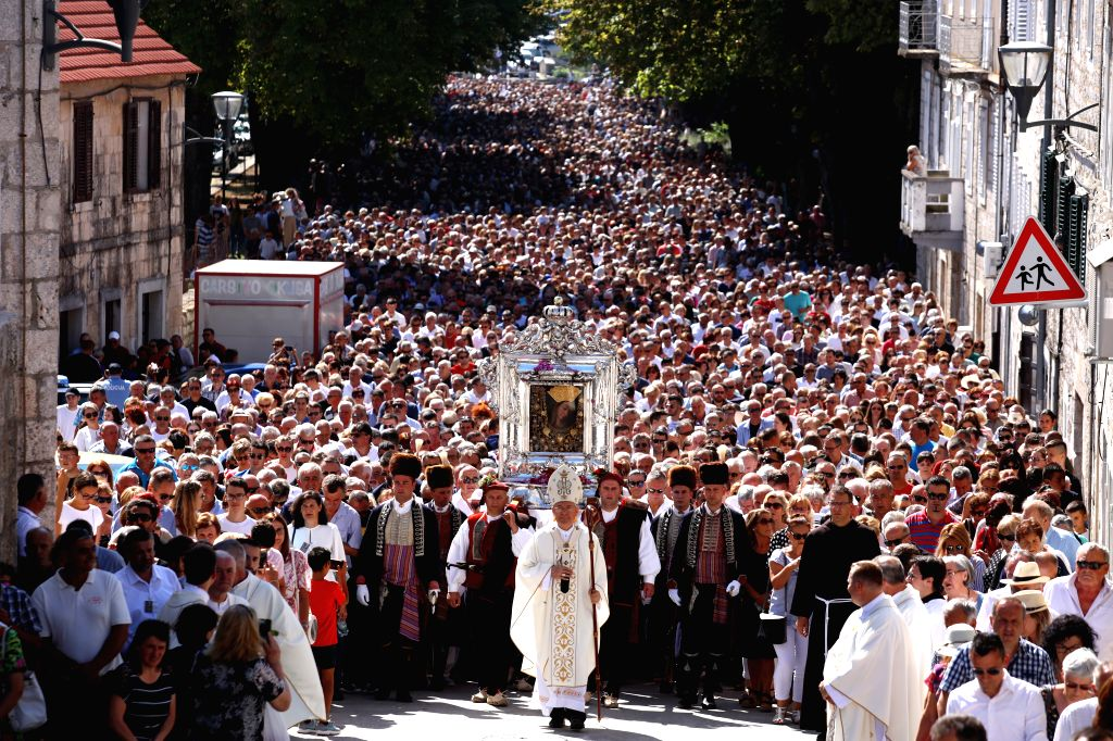 SINJ, Aug. 16, 2019 - People participate in a religious ceremony to mark the Assumption Day in Sinj, Croatia, on Aug. 15, 2018.