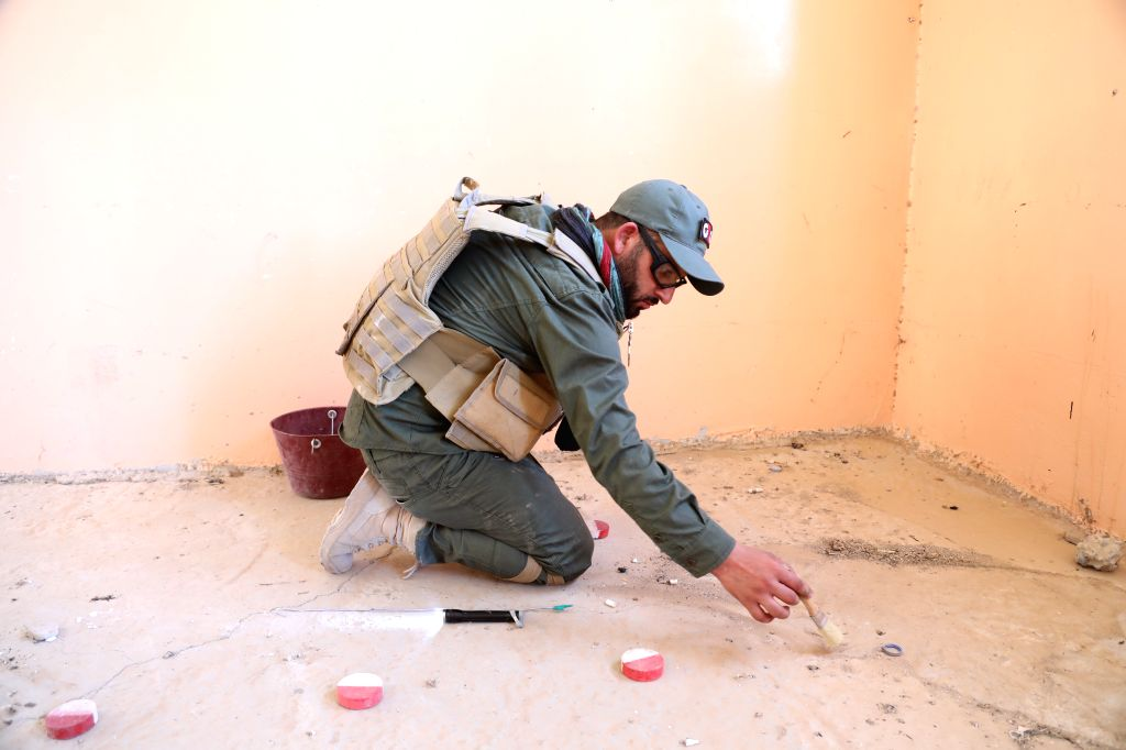 SINJAR (IRAQ), Aug. 10, 2019 Photo taken on July 4, 2019 shows a man searching for explosive devices in a school on the edges of Sinjar, Iraq. After five years of massive atrocities ...