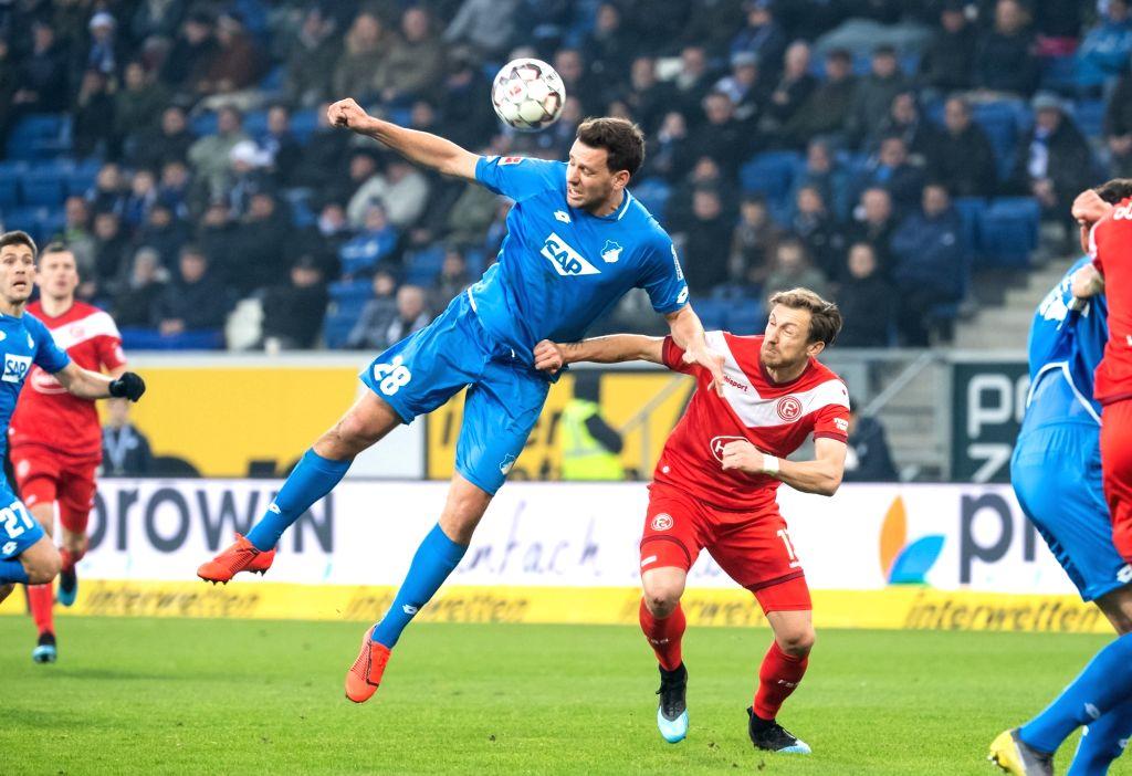 SINSHEIM, Feb. 3, 2019 - Hoffenheim's Adam Szalai (up) vies with Duesseldorf's Adam Bodzek during a German Bundesliga match between TSG 1899 Hoffenheim and Fortuna Duesseldorf, in Sinsheim, Germany, ...