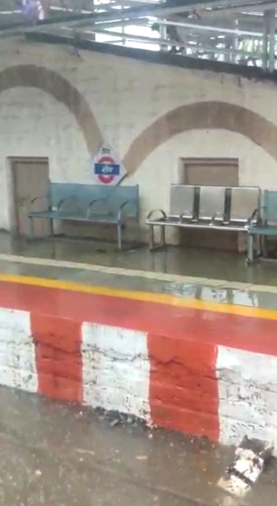Sion station rain water on track.