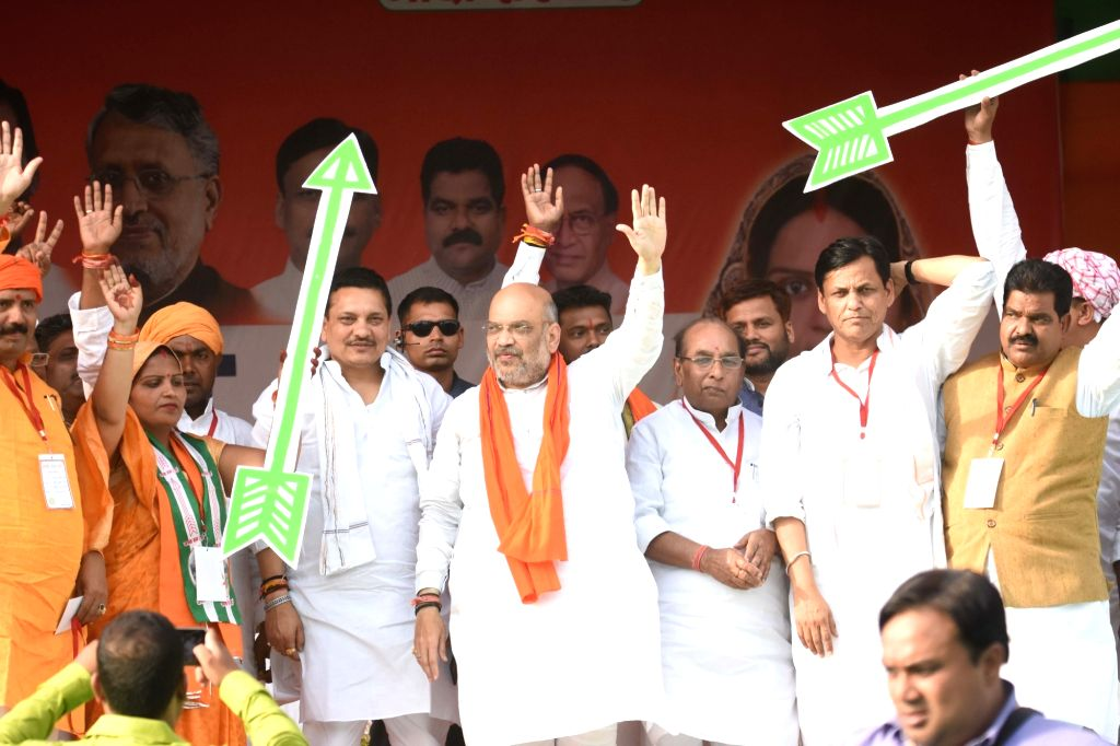 Siwan: BJP chief Amit Shah and Bihar party President Nityanand Rai wave at supporters during a public rally in Bihar's Siwan, on May 6, 2019. (Photo: IANS) - Amit Shah and Nityanand Rai