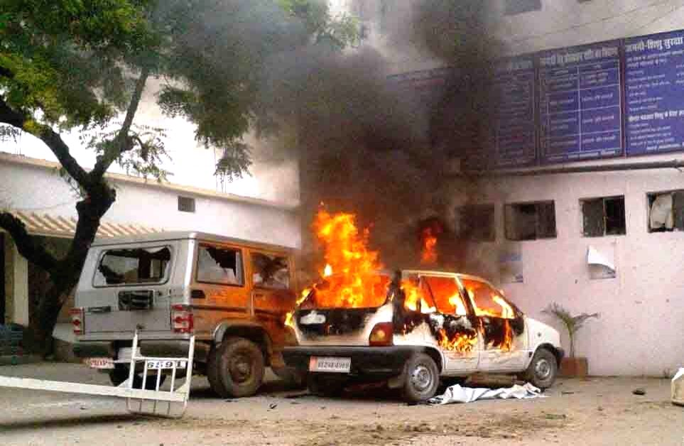 Villagers in Bihar's Siwan district set vehicles ablaze during a protest against the death of five students in a road accident on April 20, 2015. The students were going to Siwan in an auto ...