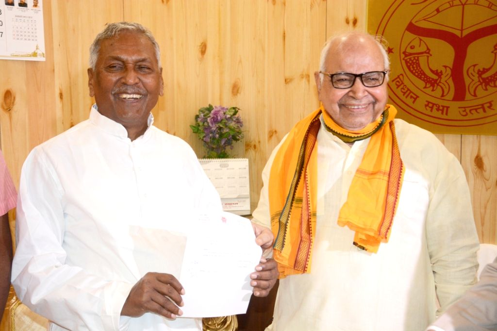 Six-time MLA Fagu Chauhan submits his resignation to the Uttar Pradesh Assembly Speaker Hriday Narayan Dikshit after being appointed as Bihar Governor, in Lucknow on July 26, 2019. - Hriday Narayan Dikshit and Fagu Chauhan