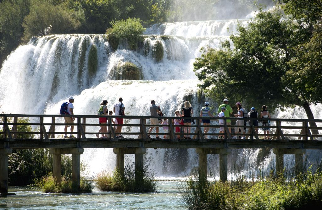 People view the Skradinski Buk waterfall at the Krka National Park, one of Croatia's best-known nature sites and tourist destinations, in Skradin near Sibenik, ...