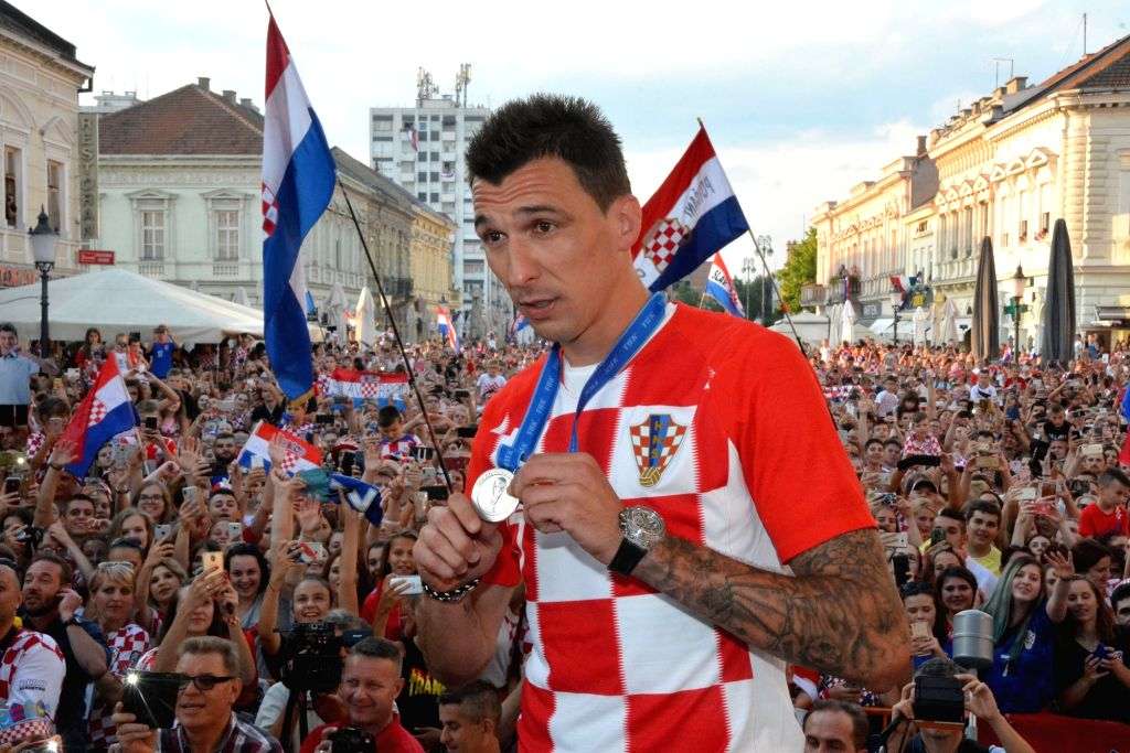 SLAVONSKI BROD, July 19, 2018 - Mario Mandzukic of Croatian national football team shows his medal during welcome celebration in Slavonski Brod, Croatia, July 18, 2018. Croatia won the second place ...