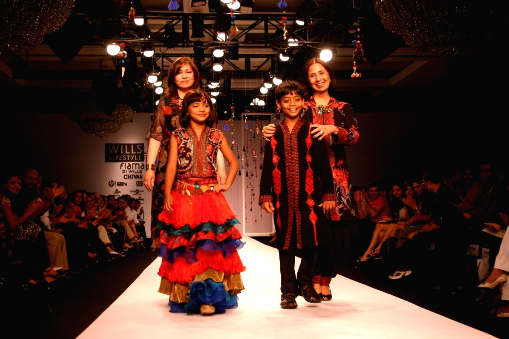 Slumdog Actors Azhar and Rubina walk the ramp for designers Ashima-Leena at Wills Lifestyle India Fashion Week in New Delhi on March 19. - Azhar and Rubina
