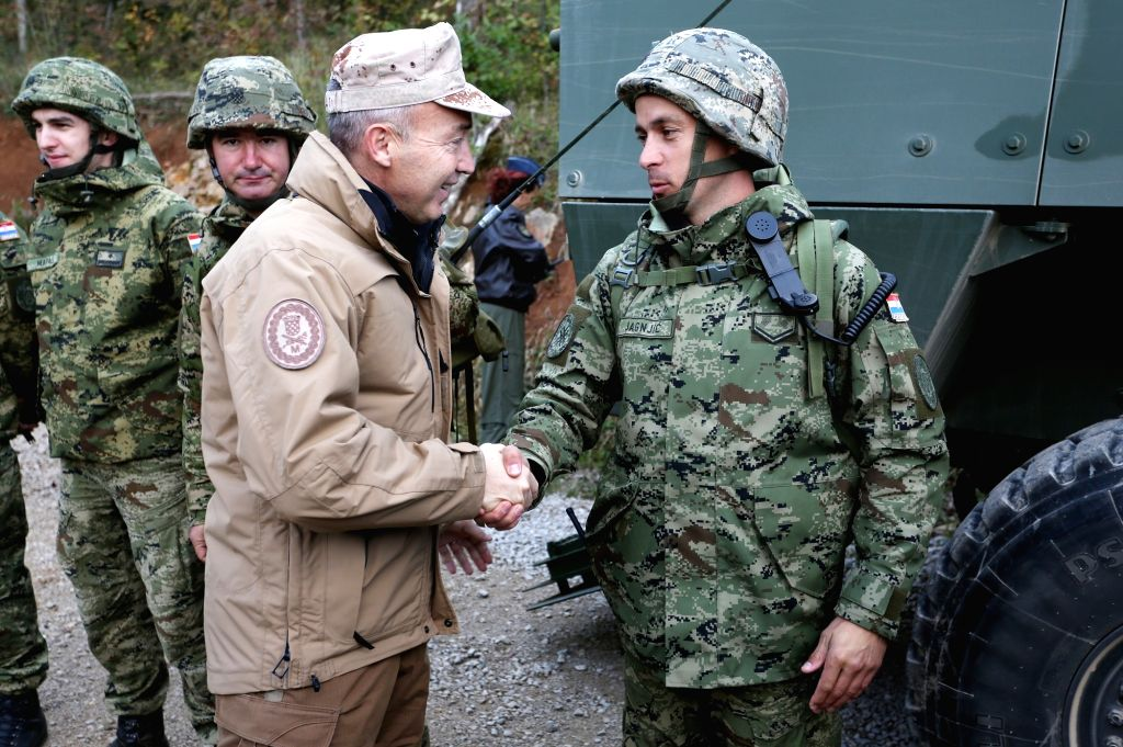"""SLUNJ, Oct. 3, 2017 - Croatian Defense Minister Damir Krsticevic (L) shakes hands with a soldier during the military exercise """"Udar 17"""" in the Eugen Kvaternik military training area near ... - Damir Krsticevic"""