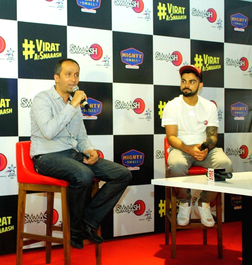 Smaaash CMO Ashok Cherian and cricketer Virat Kohli during a programme in Noida on June 24, 2016. - Virat Kohli
