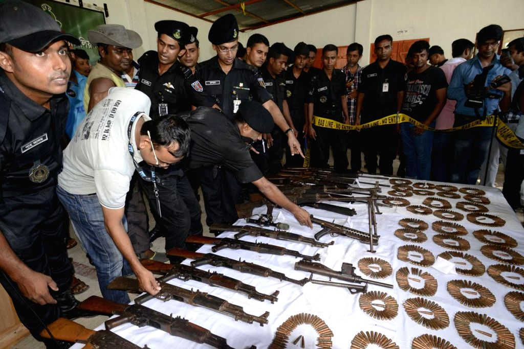 Small arms and ammunition recovered from Sylhet's Satchharhi forest displayed at RAB-9's Srimangal camp, Bangladesh on Sept 2, 2014.