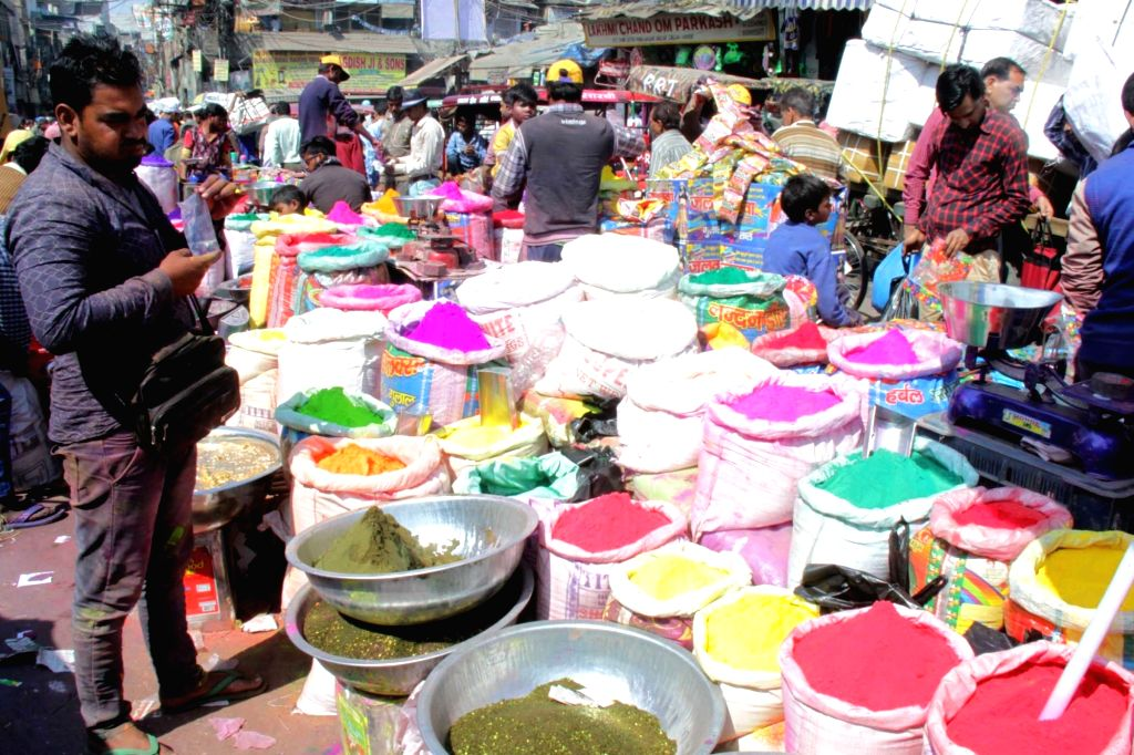 Smalltime traders sell colours ahead of Holi at Sadar Bazaar in New Delhi, on March 10, 2017.