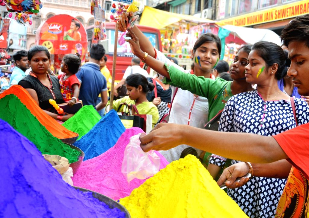 Smalltime traders sell colours ahead of Holi in Kolkata, on March 10, 2017.