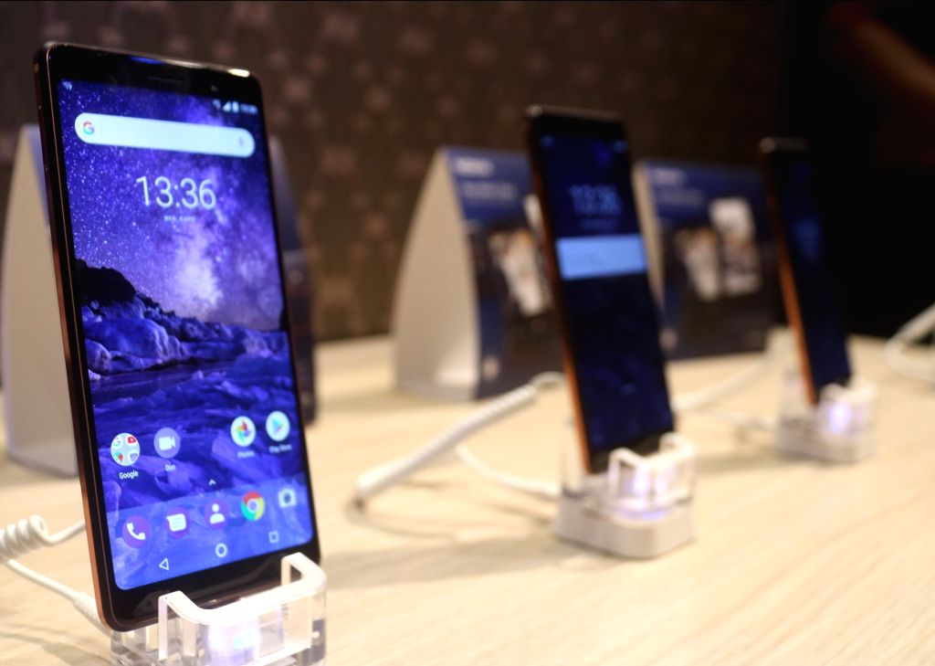 Smartphones on display during the launch of Nokia 6, 7 Plus and 8 Sirocco smartphones, in New Delhi on April 4, 2018.