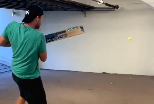 Smith working on hand-eye coordination through isolation batting.