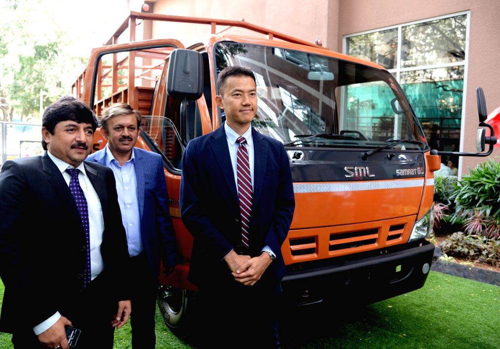 SML Isuzu Senior Vice President Jungji Tonoshima along with General manager Sales Naval Kumar Sharma and Burma Automotive Pvt Ltd Chairman K K Bhatha at the launch of SML Isuzu new ... - Naval Kumar Sharma