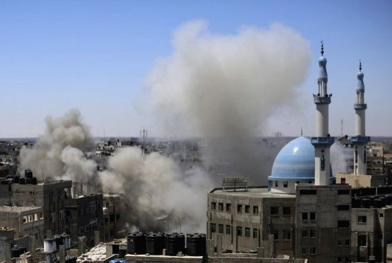 Smoke billows following an Israeli airstrike on a house are seen in the southern Gaza Strip city of Rafah, May 15, 2021.