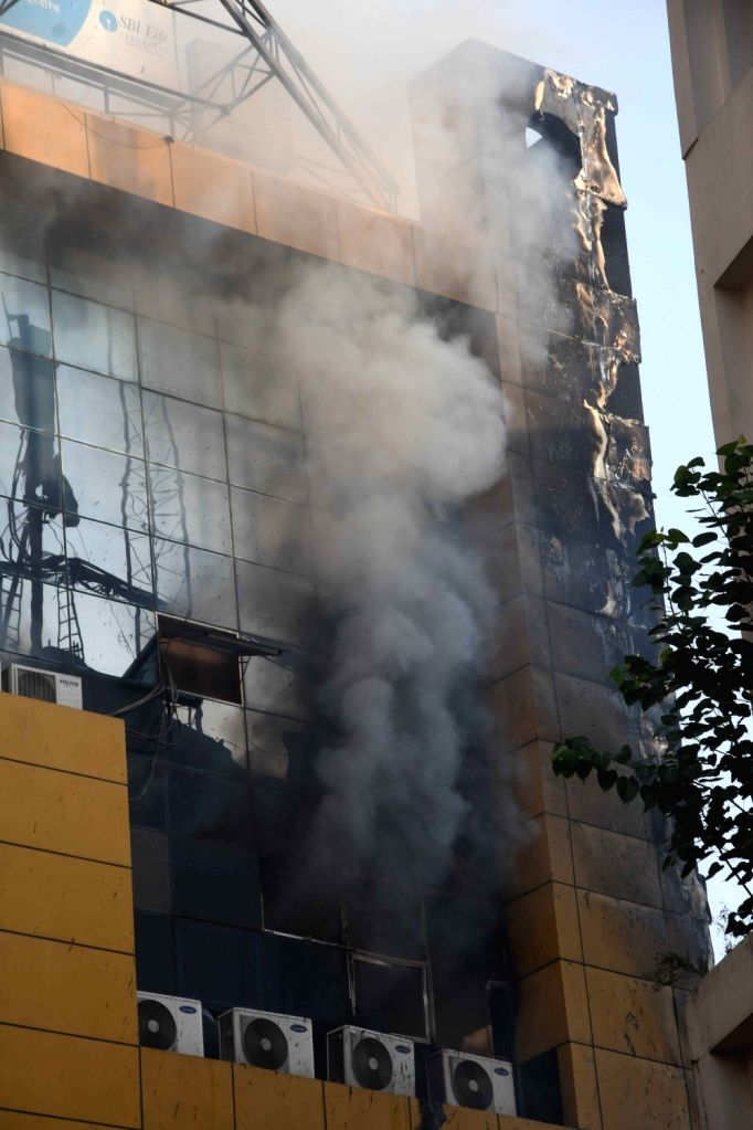Smoke billows out after a fire broke out at a shopping mall located at Boring Road in Patna on May 20, 2017.