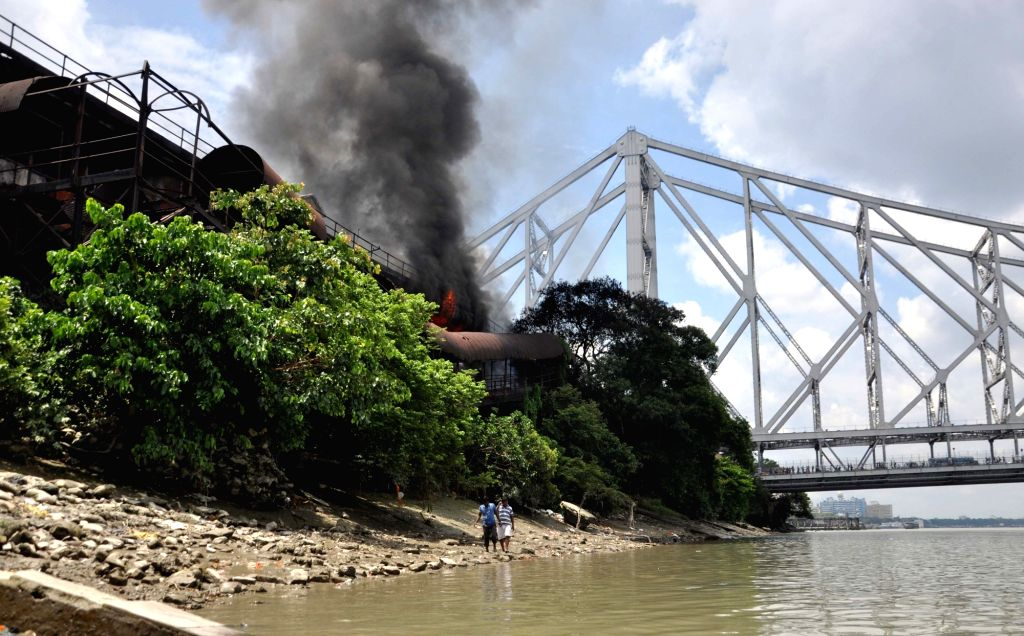 Smoke billows out of the chemical godown where a massive fire broke out near Jagannath Ghat in Kolkata, on June 8, 2019.