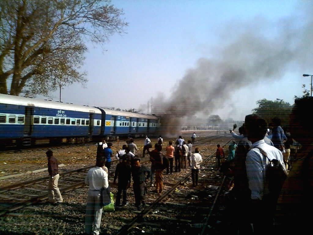 Smoke billows out of the engine of Rewari Express that caught fire at Patel Nagar of New Delhi on March 29, 2016.