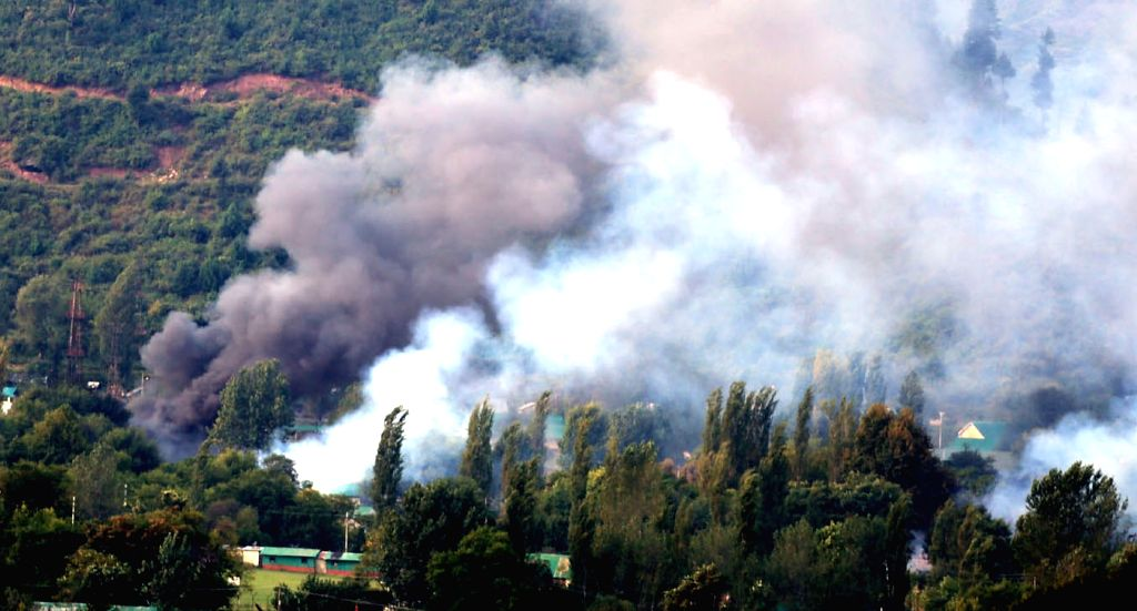 Smoke billows out of Uri army camp that was attacked by terrorists on Sept 18, 2016.