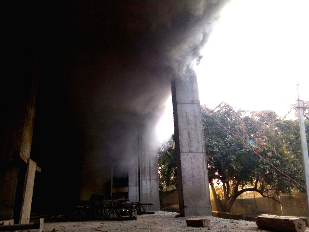 Smoke comes out after a fire broke out on the first floor of the GHMC office in Khairatabad, Hyderabad on Feb 6, 2018.