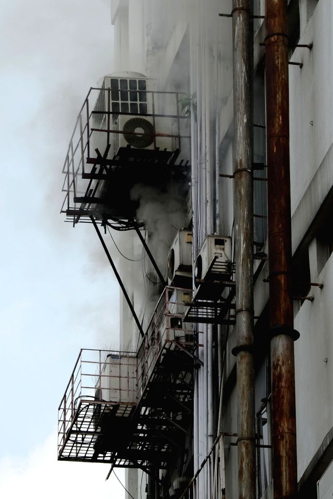Smoke comes out from an office building after it caught fire in Kolkata on Tuesday 08 June, 2021.
