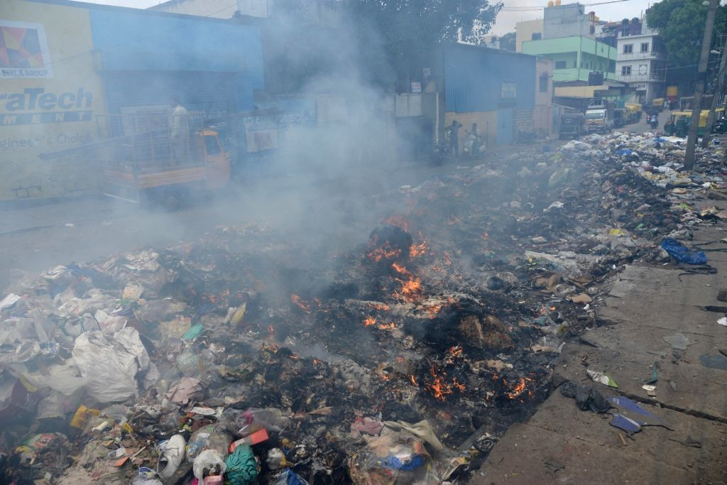 Smoke comes out of a pile of garbage being burnt, in Bengaluru on June 5, 2018. June 5 is observed as World Environment Day.
