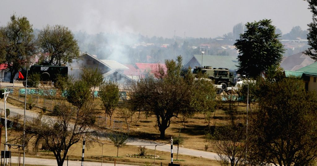 Smoke erupts out of the BSF camp near the highly secured Srinagar international airport that was stormed by suicide attackers of Pakistan-based Jaish-e-Mohammed terror outfit carrying guns ...