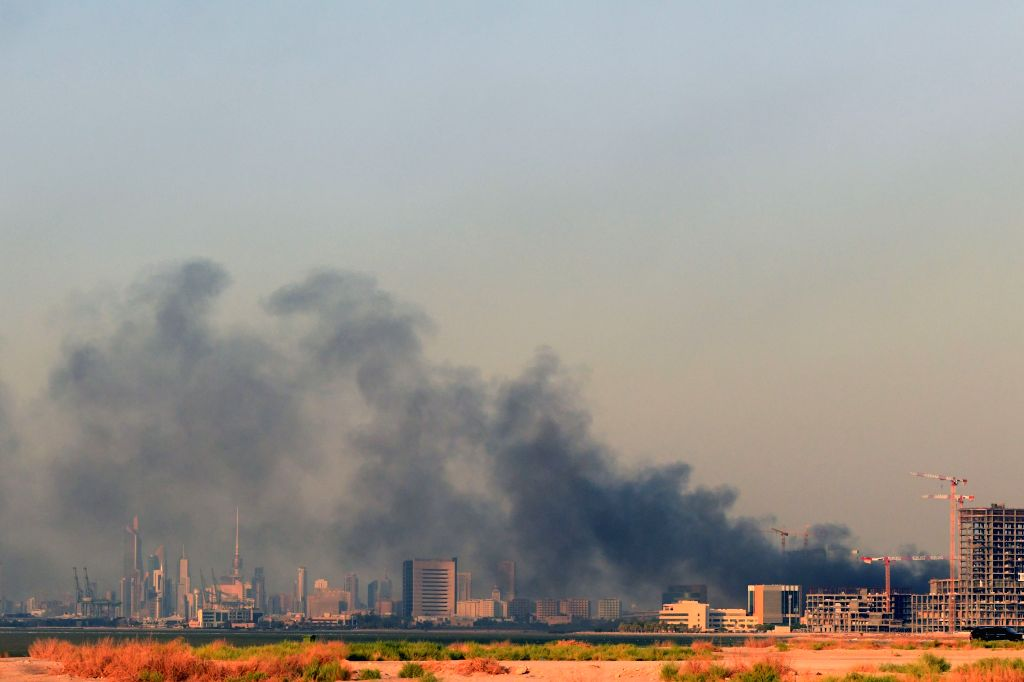 Smoke rises after a fire erupted at the Al-Sabah health zone in Kuwait City, Kuwait, on Sept. 12, 2020. A huge fire erupted Saturday afternoon at the Al-Sabah ...