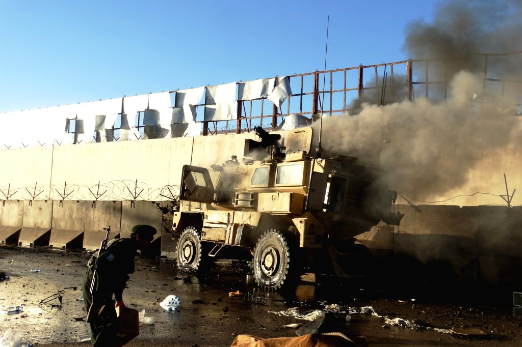 Smoke rises from a blast site in Lashkar Gah, capital of southern Helmand province, Afghanistan, Nov. 15, 2015. At least one police personnel was killed and 11 ...