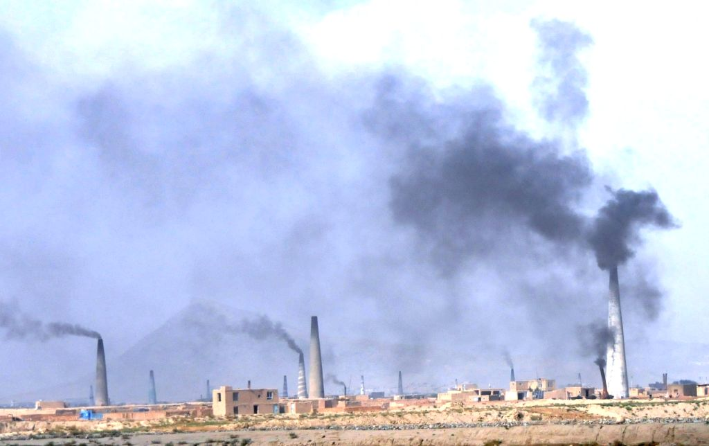 Smoke rises from brick factories on the outskirt of Kabul city, capital of Afghanistan, Nov. 29, 2015. The volume of pollution in Kabul city, where the country's ...