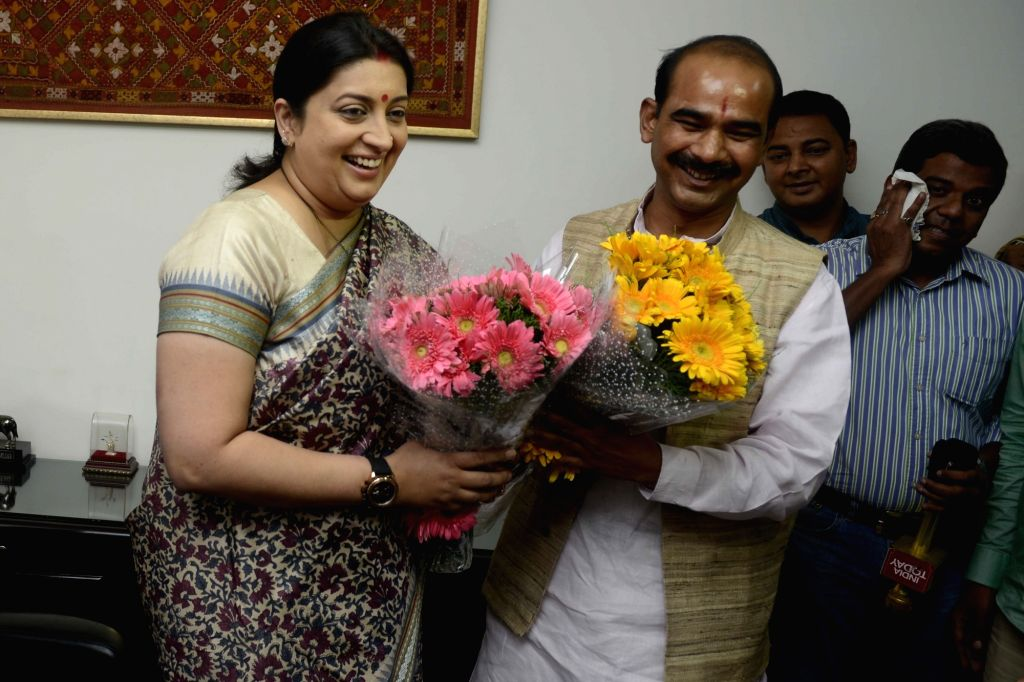 Smriti Irani with Ajay Tamta as she assumes charge as as Union Textile Minister in New Delhi, on July 6, 2016. - Smriti Irani